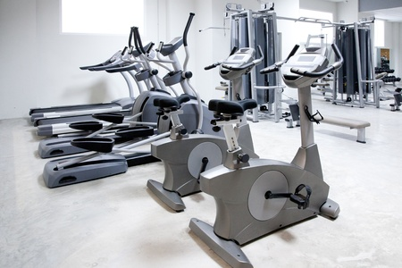 kilograms: elliptical cross trainer, stationary bicycle and treadmill in gym