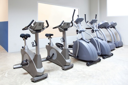 elliptical cross trainer, stationary bicycle and treadmill in gym Stock Photo - 11982266