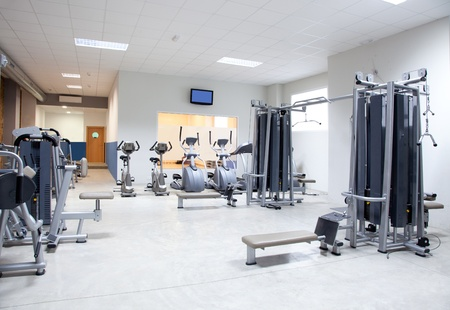 fitness club: Fitness club gym with sport equipment modern interior