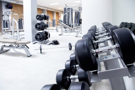 Fitness club weight training equipment gym modern interior 版權商用圖片