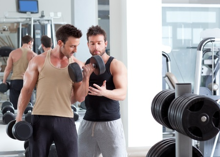 gym personal trainer man with weight training equipment Stock Photo - 11982202