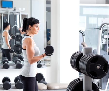 woman with weight training equipment on sport gym club Stock Photo - 11982055