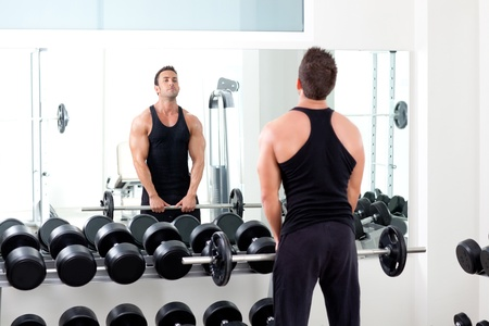 man with dumbbell weight training equipment on sport gym photo