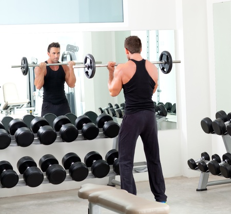 man with dumbbell weight training equipment on sport gym Stock Photo - 11982122