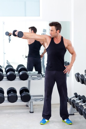 man with weight training equipment on sport gym club Stock Photo - 11982248