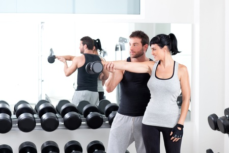 gym woman personal trainer man with weight training equipment Stock Photo - 11982282