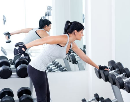 woman with weight training equipment on sport gym club Stock Photo - 11982262