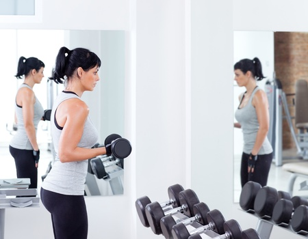 woman with weight training equipment on sport gym club Stock Photo - 11982050