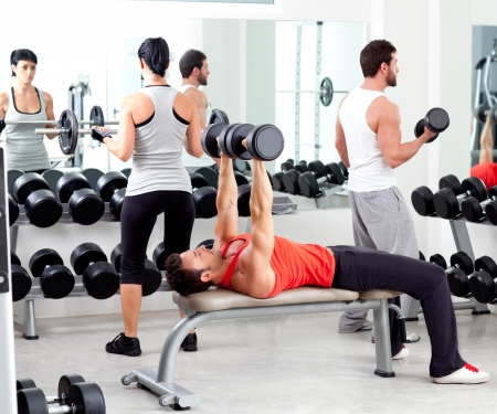 group of people in sport fitness gym weight training equipment indoor photo
