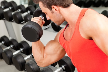 man with weight training equipment on sport gym club Stock Photo - 11982134