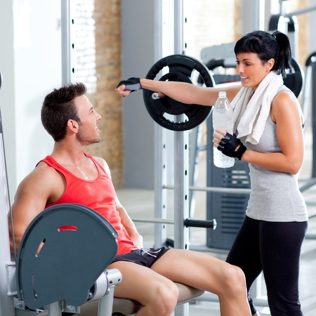 man and woman friends on sport fitness gym relaxed Stock Photo - 11982119