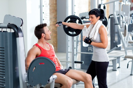 man and woman friends on sport fitness gym relaxed Stock Photo - 11982251