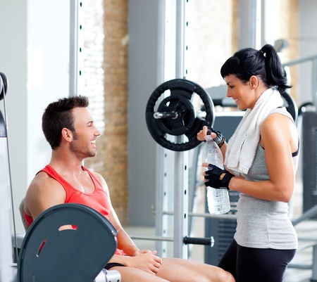man and woman friends on sport fitness gym relaxed Stock Photo - 11982247