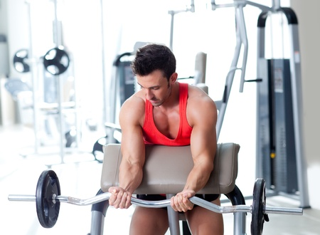 man with weight training equipment on sport gym club photo
