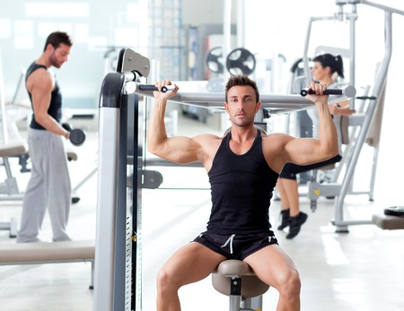 fitness instructor: fitness sport gym group of people training with weights Stock Photo