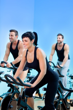 Stationary spinning bicycles fitness girl in a gym sport club photo