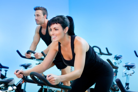exercice: Stationary spinning bicycles fitness girl in a gym sport club Stock Photo