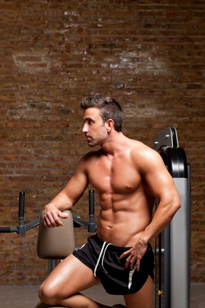 fitness shaped muscle man posing on dark gym  photo