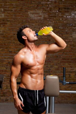 muscle shaped man at gym relaxed drinking energy drink Stock Photo - 11982229