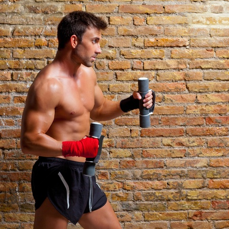 dumb: muscle boxer man with fist bandage and training weights
