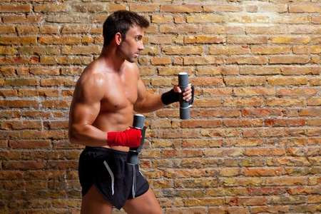 muscle boxer man with fist bandage and training weights photo