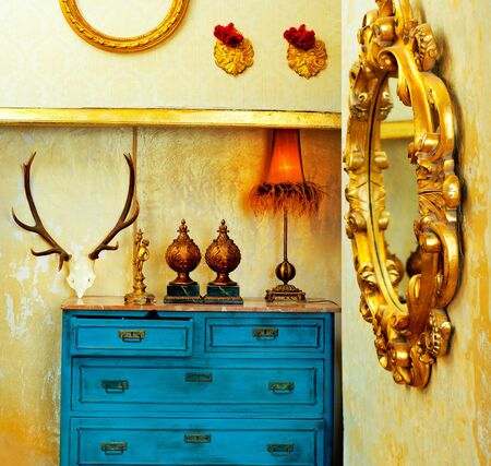 baroque grunge vintage house with blue drawer and golden mirror photo