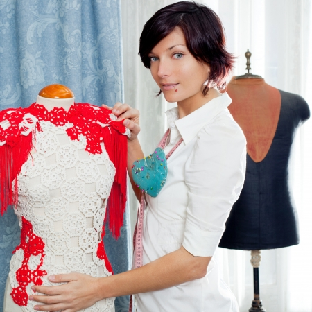 blouse: Dressmaker with mannequin as professional fashion designer Stock Photo