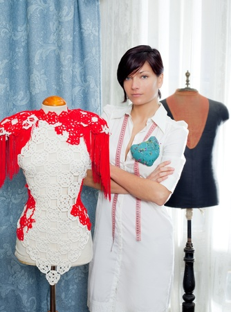 Dressmaker with mannequin as professional fashion designer Stock Photo - 12148068