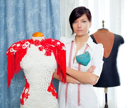 Dressmaker with mannequin as professional fashion designer Stock Photo - 12144787
