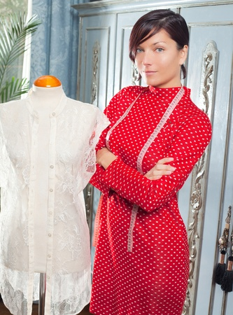 Dressmaker with mannequin as professional fashion designer Stock Photo - 12148153