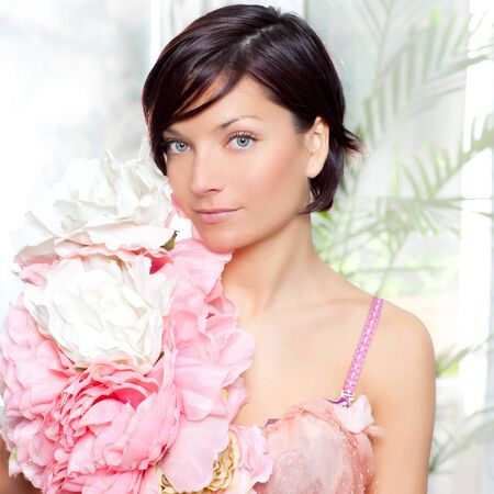 haute: beautiful flowers woman with spring pink dress portrait