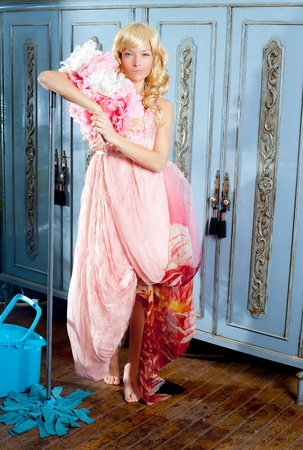 fashion vintage blond housewife with mop cleaning chores at home photo