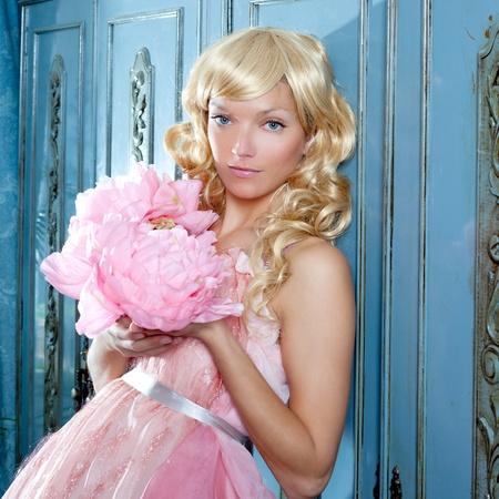 haute: blond fashion princess and vintage spring flowers dress on blue wardrobe