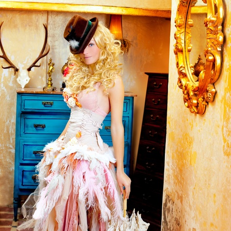 blond fashion woman in vintage grunge baroque house with umbrella