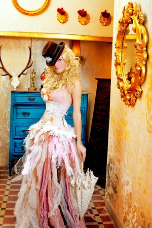 blond fashion woman in vintage grunge baroque house with umbrella photo