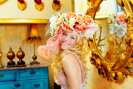 blond fashion woman with spring flowers hat in baroque grunge house photo