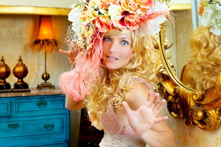 blond fashion woman with spring flowers hat funny expression photo