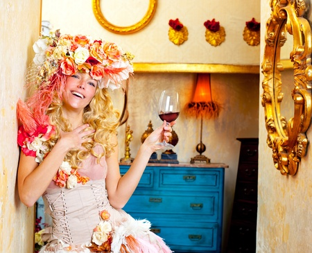 fashion baroque blond womand drinking red wine in grunge house photo