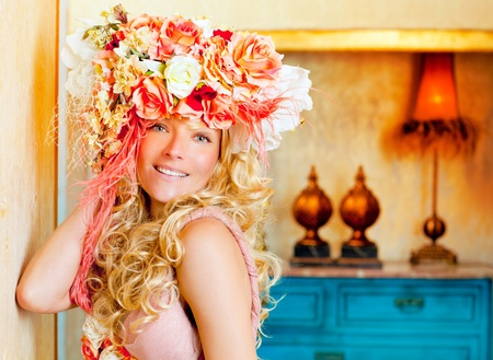 baroque fashion blonde woman in grunge interior with spring flowers hat photo