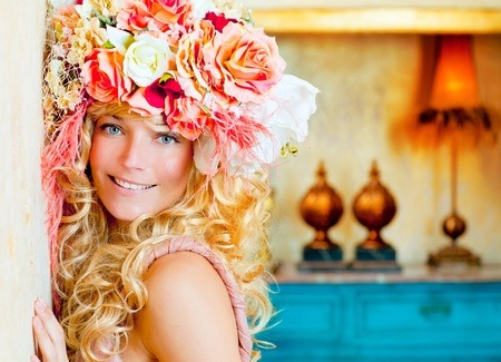 baroque fashion blonde woman in grunge interior with spring flowers hat