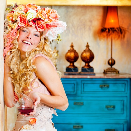 retro fashion: baroque fashion blond womand drinking red wine in grunge house