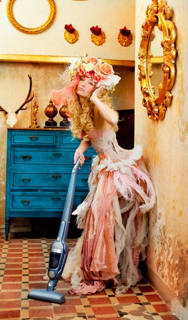 baroque fashion blonde housewife woman at vacuum cleaner chores photo