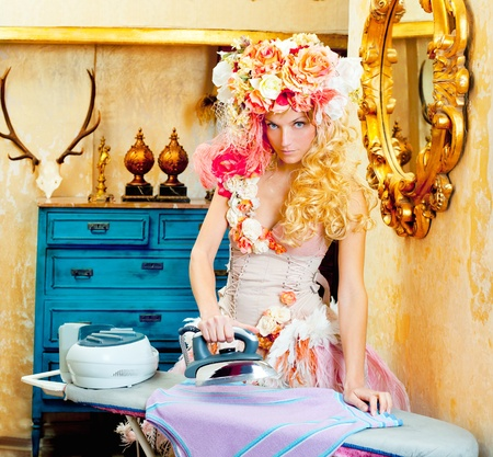 baroque fashion blonde housewife woman with iron chores photo