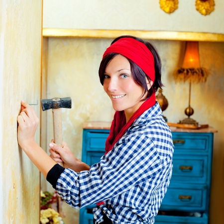 Diy fashion woman with nail and hammer on grunge house photo