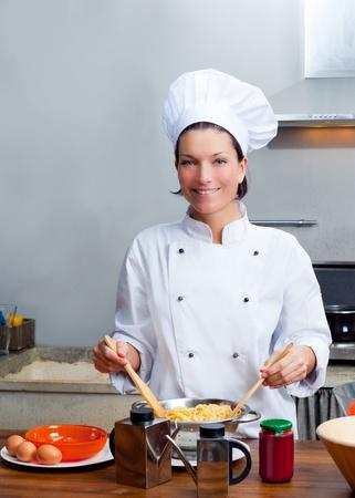 female chef: Chef woman portrait with white uniform in the kitchen Stock Photo