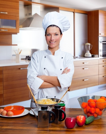 Chef woman portrait with white uniform in the kitchen Stock Photo - 12144710