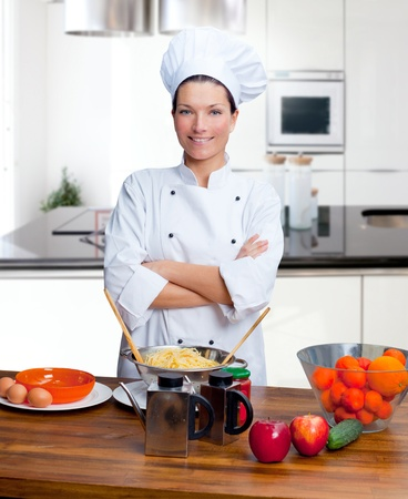 Chef woman portrait with white uniform in the kitchen Stock Photo - 12144708