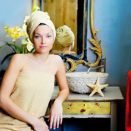 beautiful woman bathroom portrait with towel in head photo