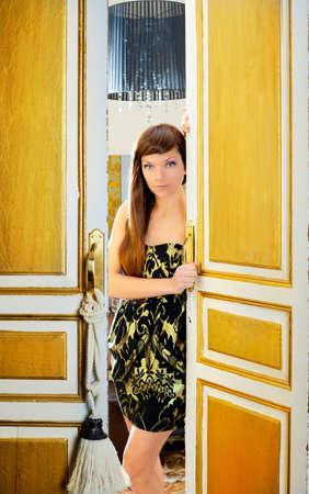 elegance fashion woman in hotel room door sensual invitation photo