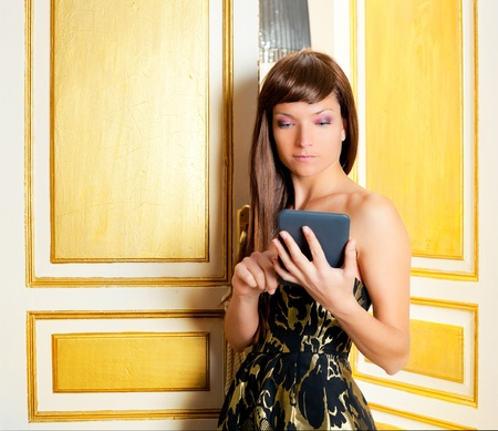 elegance fashion woman reading ebook tablet in golden door photo